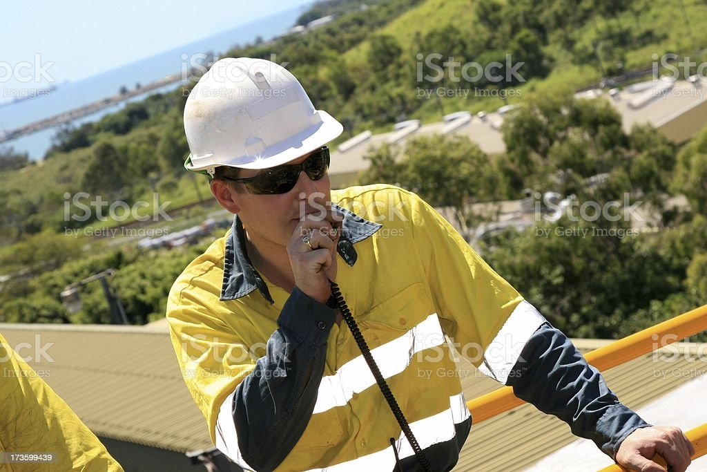 Construction Worker talking on walkie-talkie stock photo