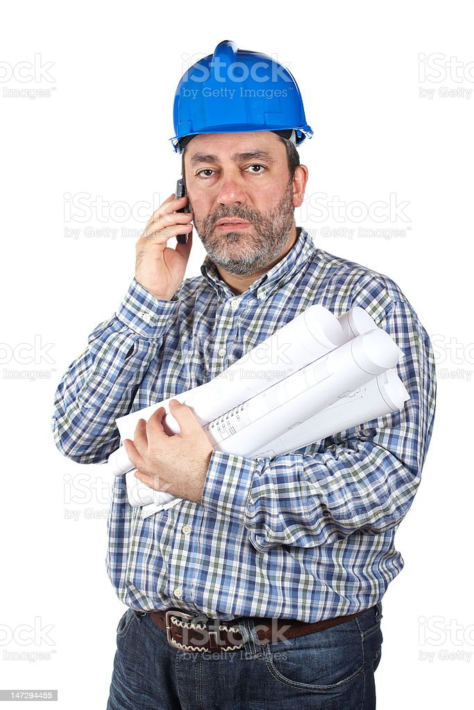 Construction worker talking with phone royalty-free stock photo