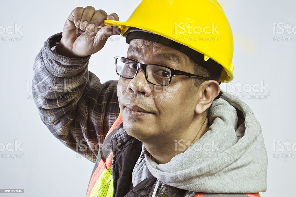 Construction Worker touches Hat royalty-free stock photo