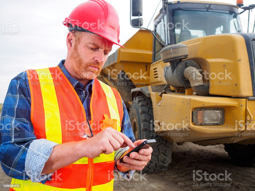 Construction worker, truck, texting and internet and engineer stock photo