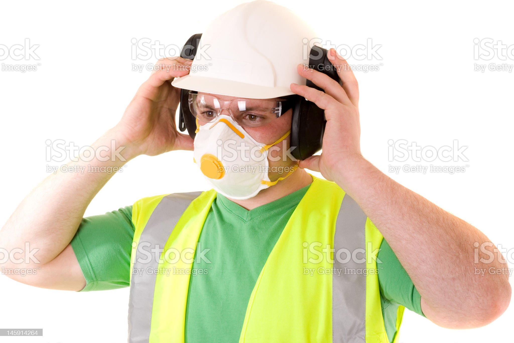 construction worker uses protective workwear royalty-free stock photo