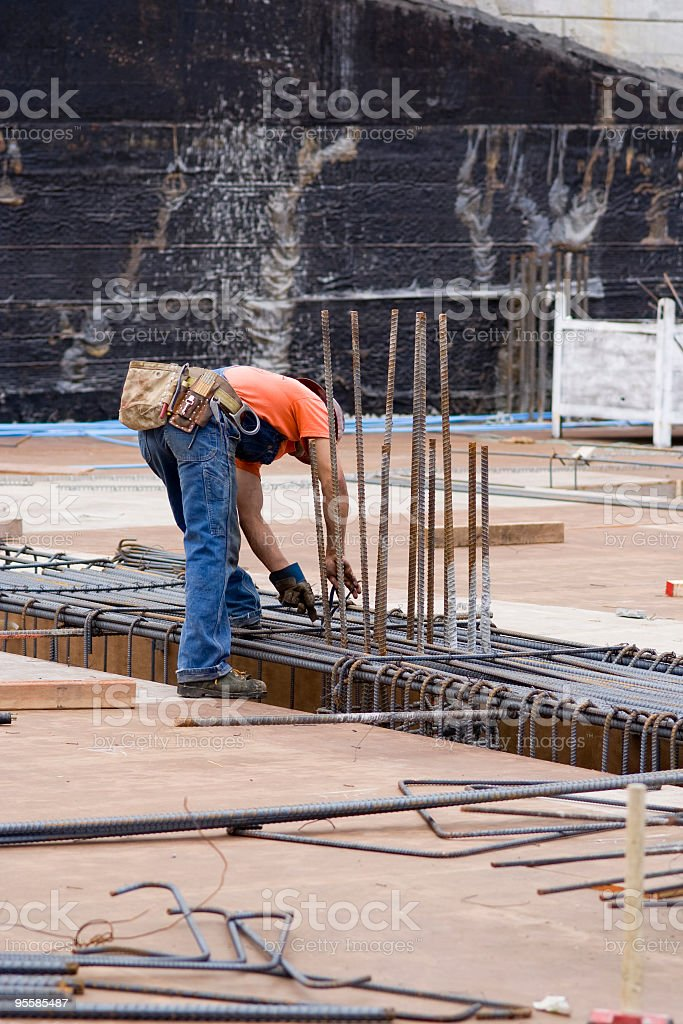Construction worker uses rebar royalty-free stock photo
