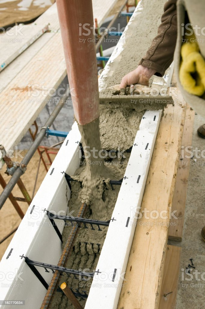 Construction Worker Using a Trowel to Level Pouring Concrete stock photo