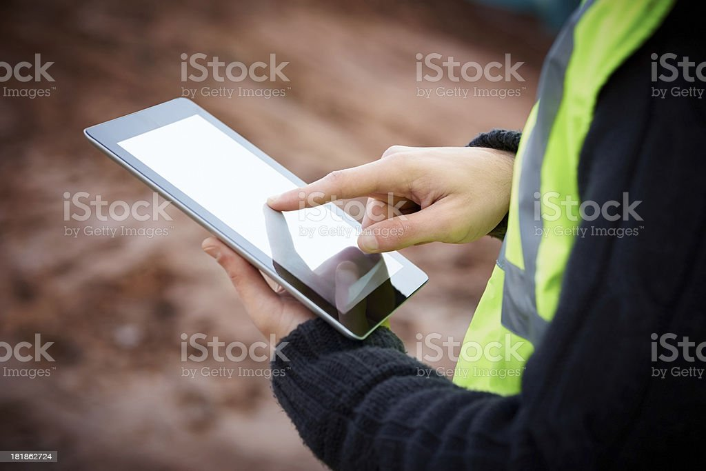 Construction worker using digital tablet stock photo
