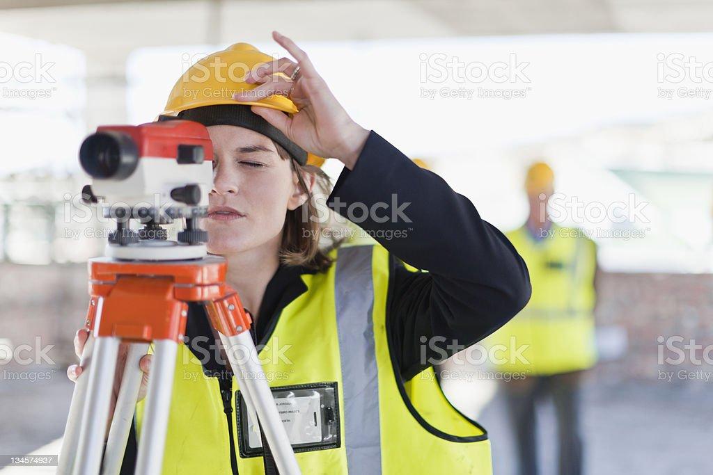 Construction worker using equipment stock photo