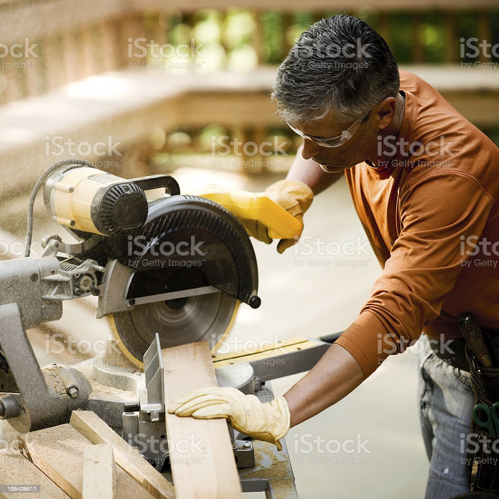 Construction Worker Using Miter Saw for Deck royalty-free stock photo