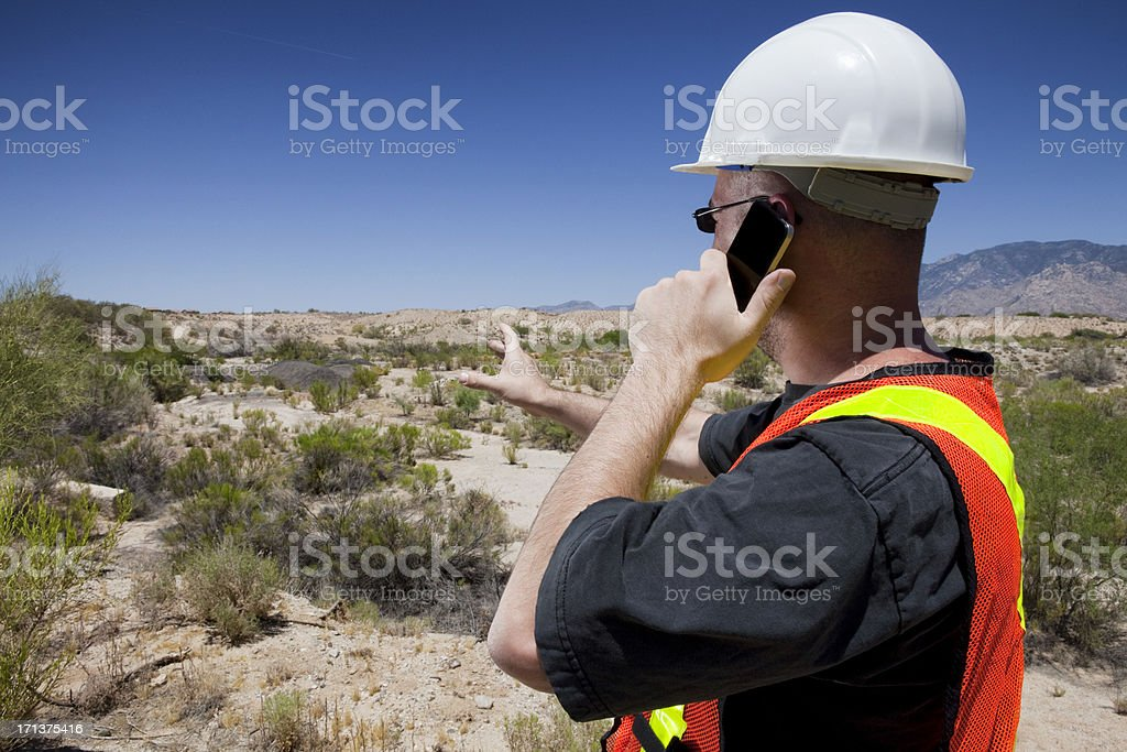 Construction Worker Using Smart Phone royalty-free stock photo
