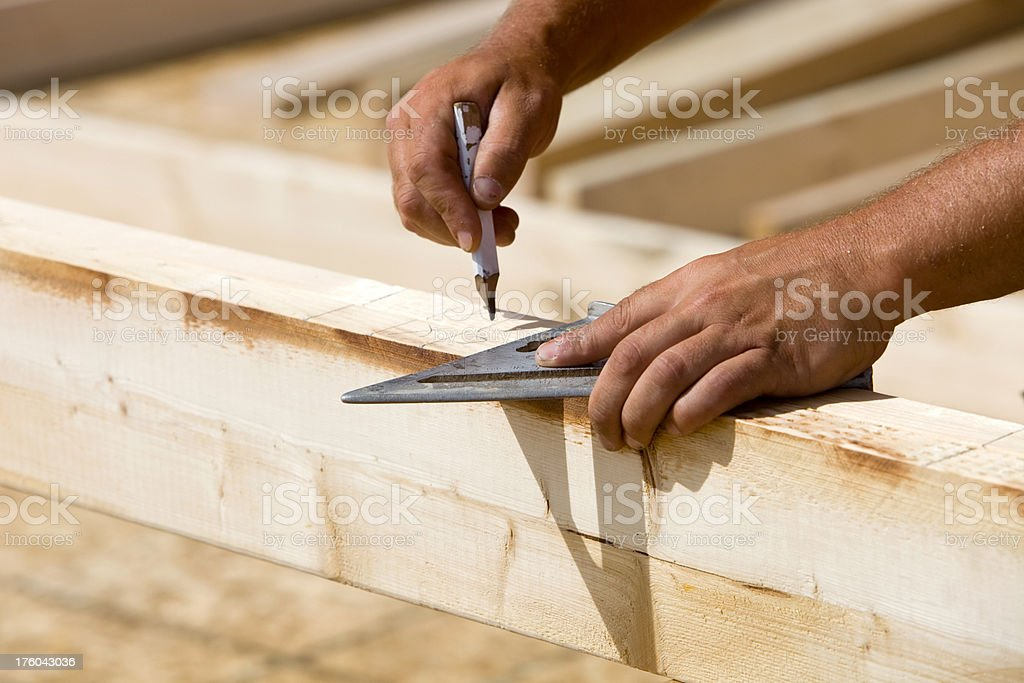 Construction Worker Using Speed Square and Marking Frame Board royalty-free stock photo