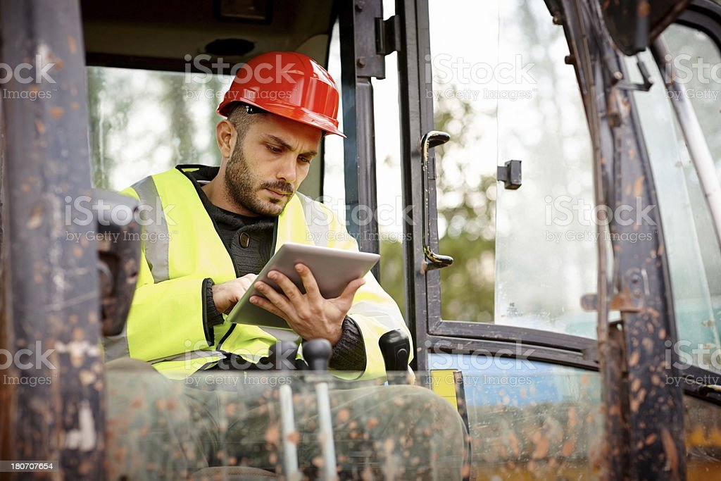 Construction worker using tablet computer stock photo