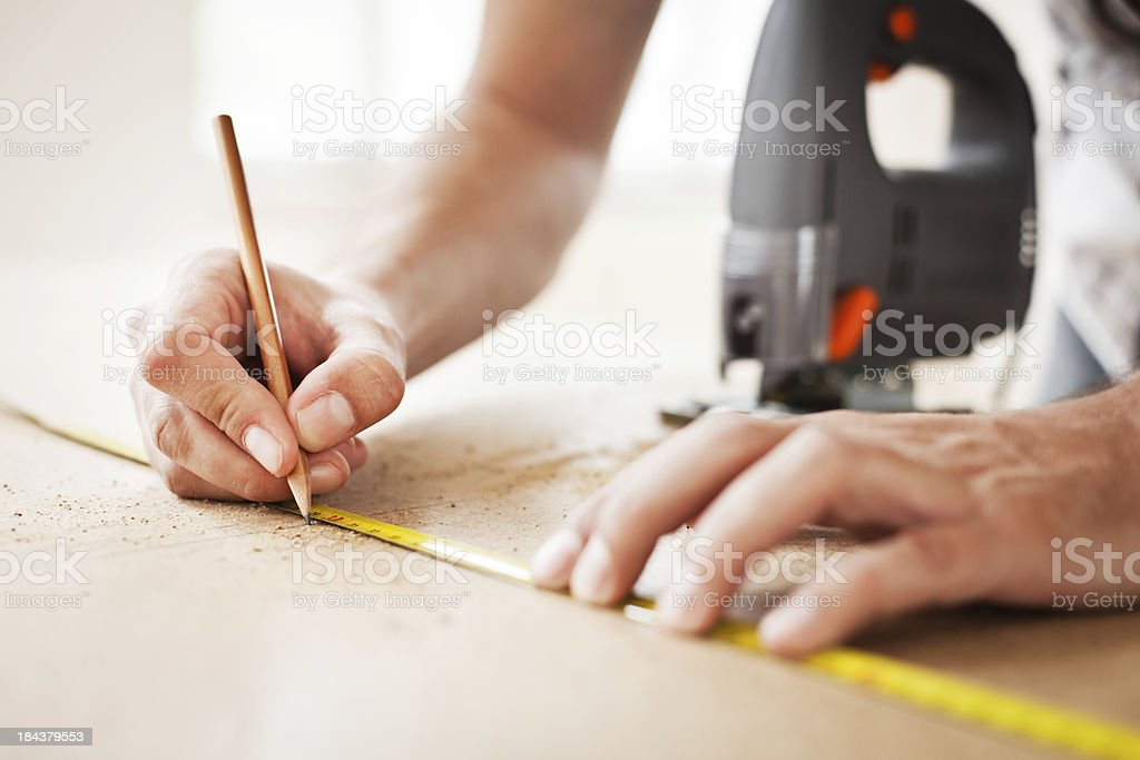 Construction Worker Using Tape Measure royalty-free stock photo