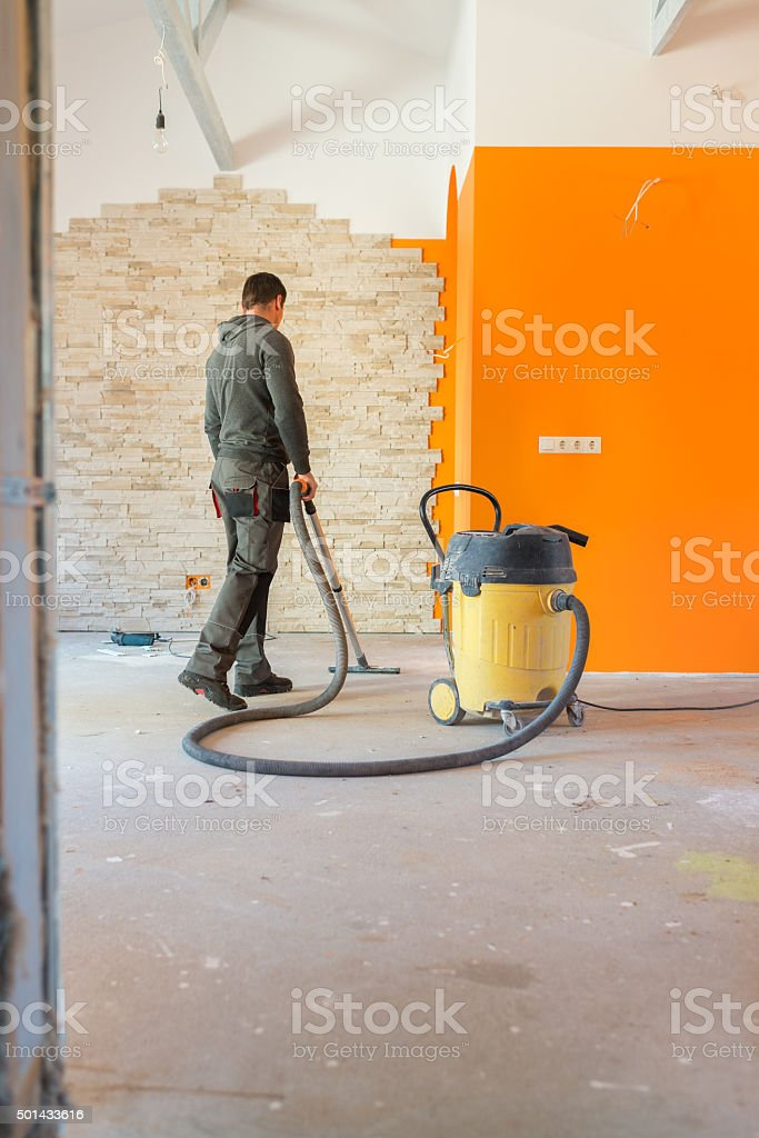 Construction worker Vacuuming Dust stock photo