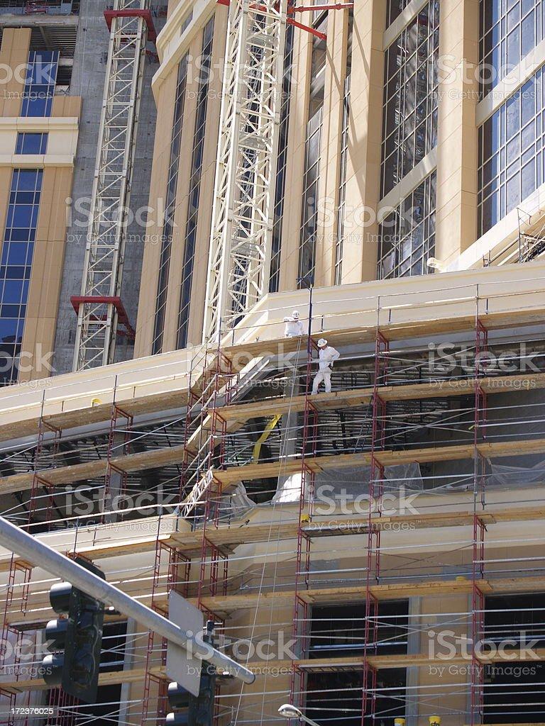 Construction Worker Walking on Scaffolding stock photo