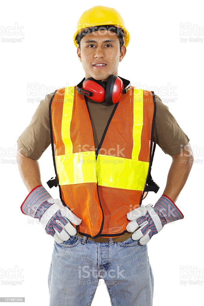 Construction worker wearing orange and yellow vest stock photo