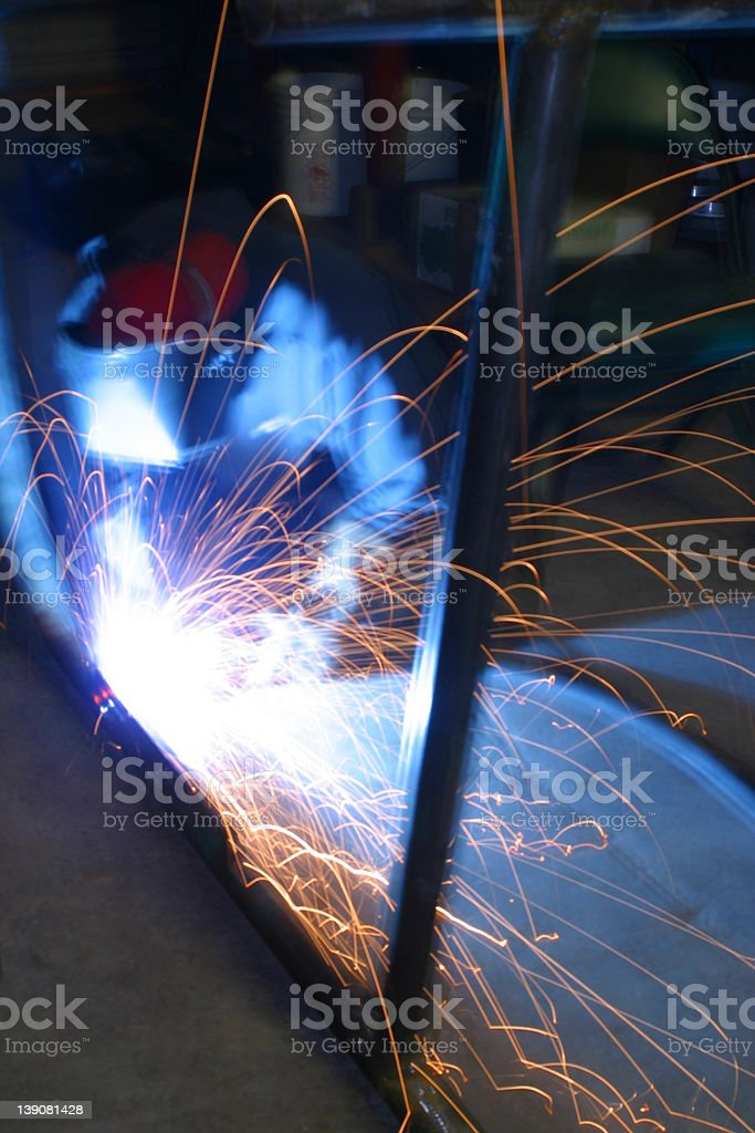 A construction worker welding steel royalty-free stock photo