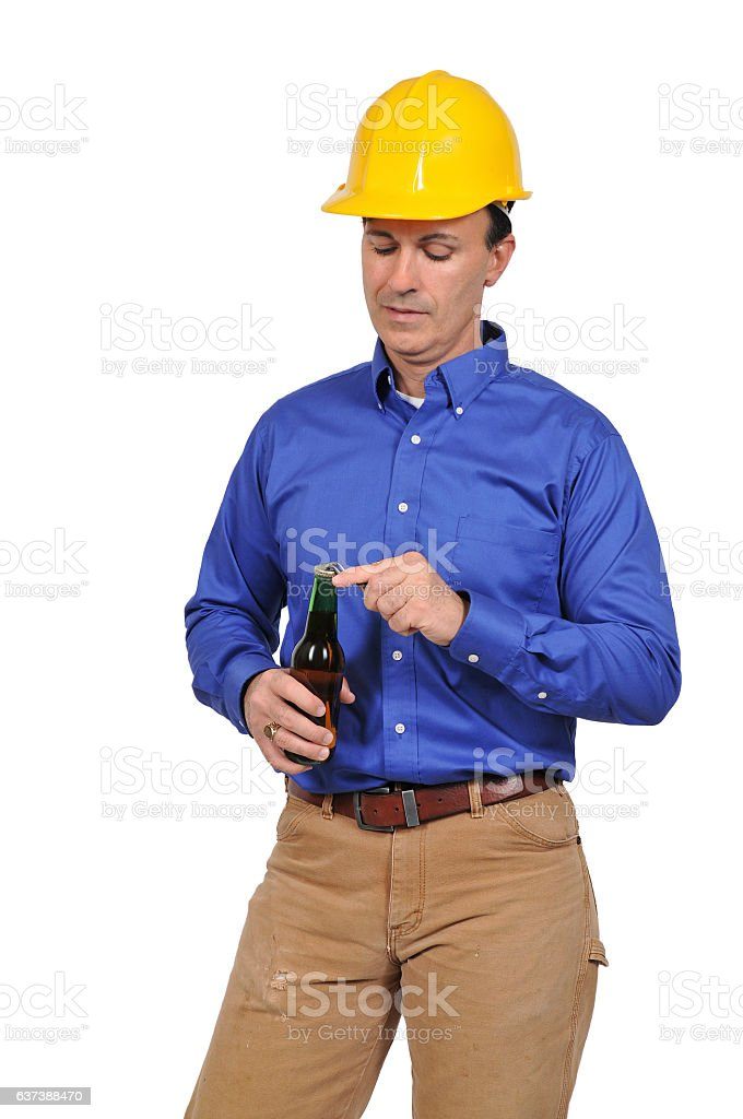 Construction Worker with a beer stock photo