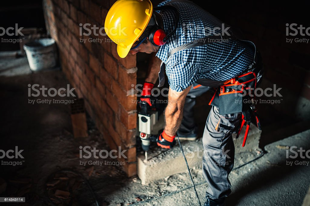 Construction worker with a drill stock photo