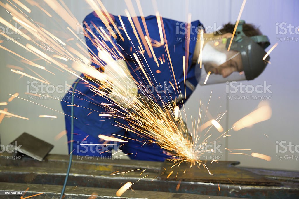 Construction worker with angle grinder royalty-free stock photo