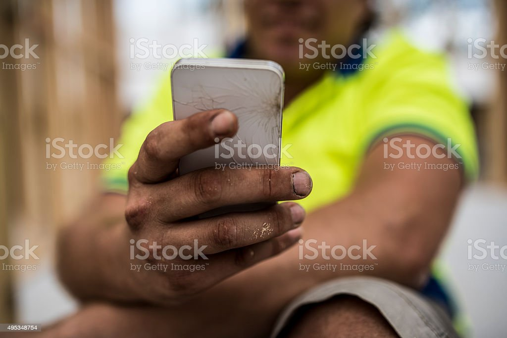 Construction Worker with Broken Mobile Phone stock photo