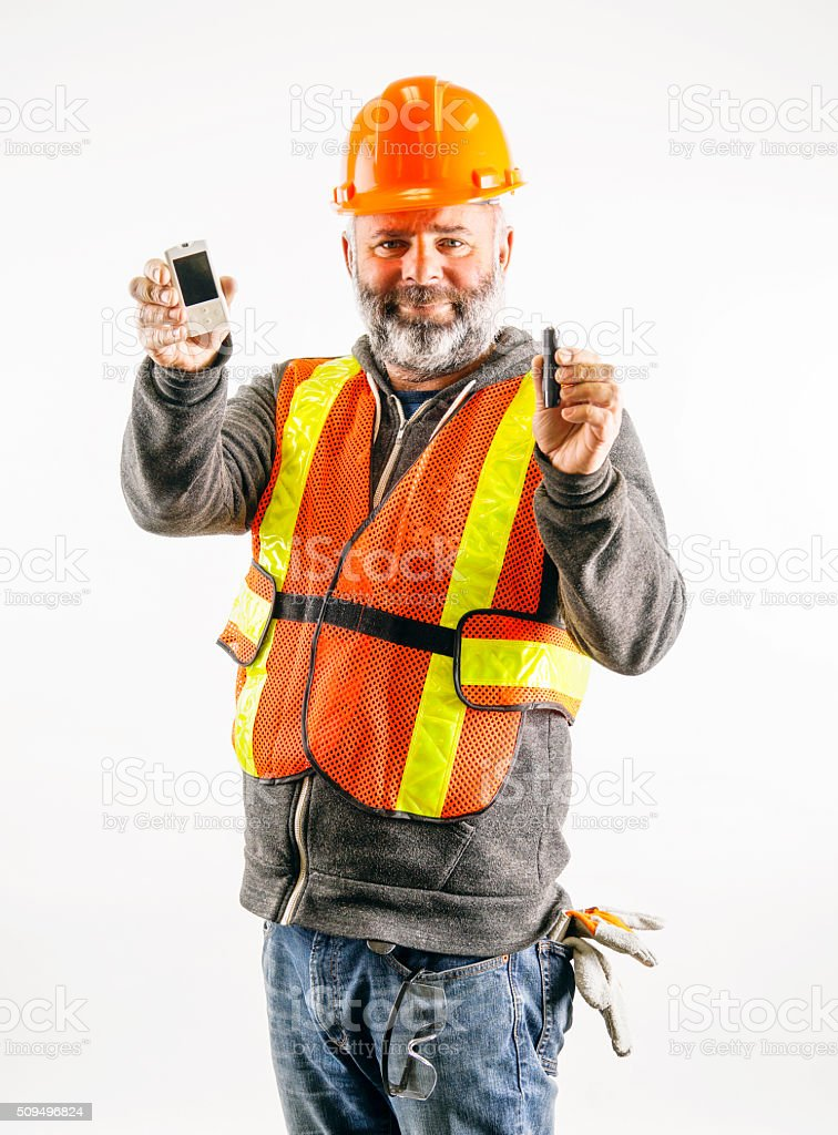Construction worker with diabetes test devices stock photo
