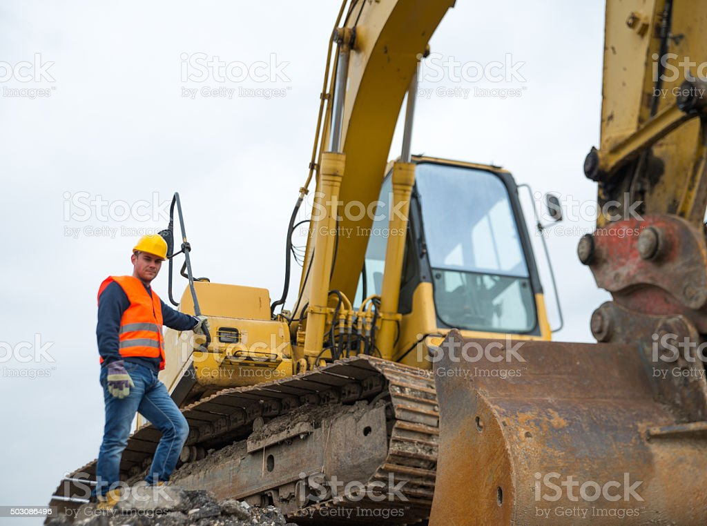 Construction worker with earth mover stock photo