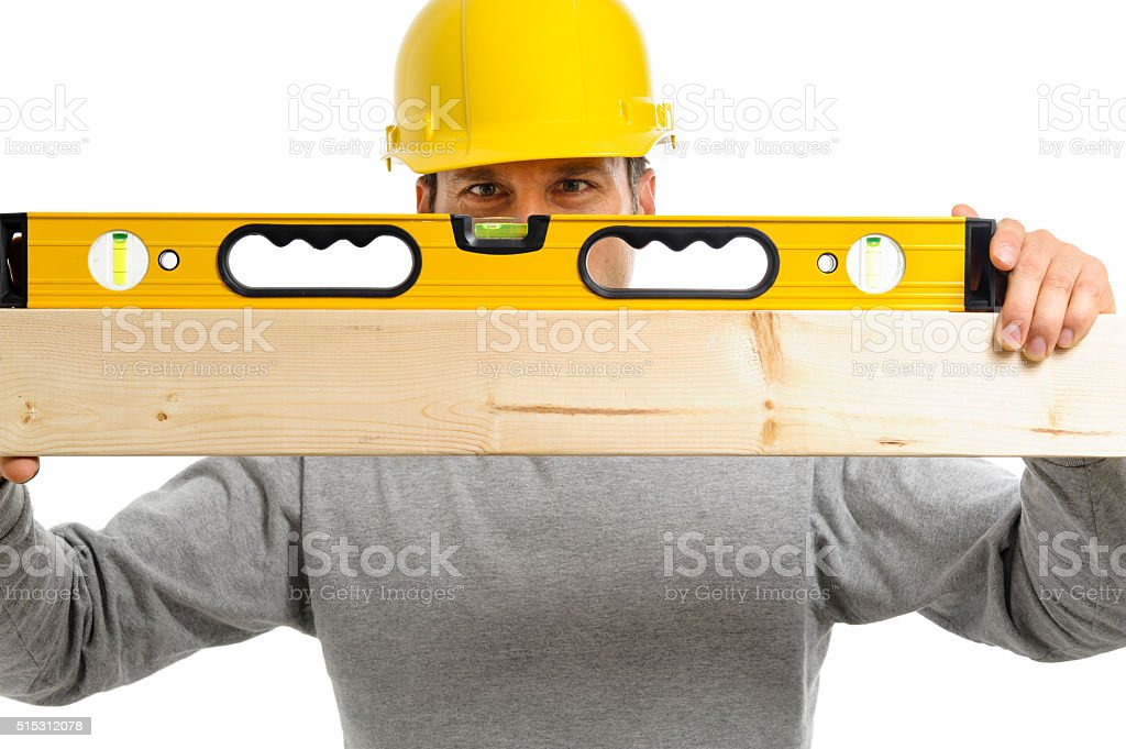 Construction worker with level stock photo