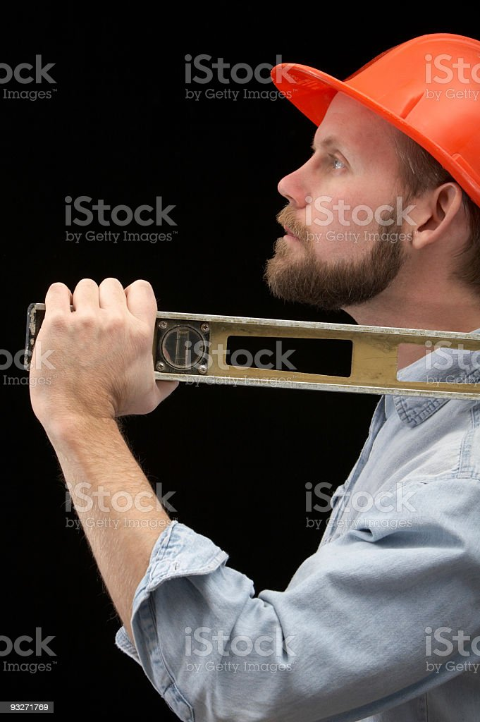 Construction Worker with Level royalty-free stock photo