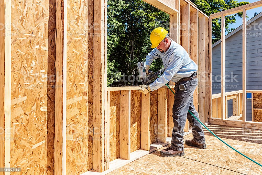 Construction Worker with Nail Gun stock photo