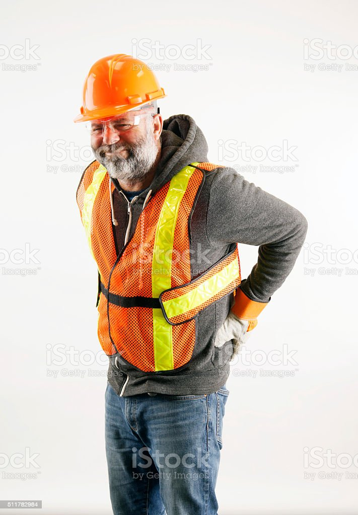 Construction worker with painful lower back injury. stock photo