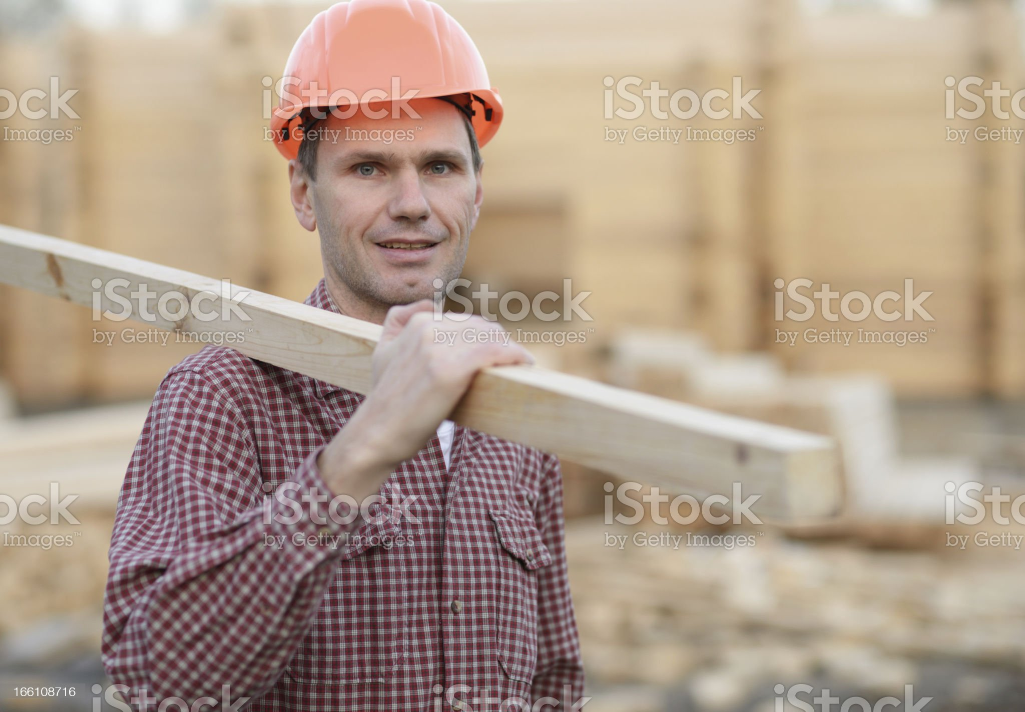 Construction worker with plank royalty-free stock photo