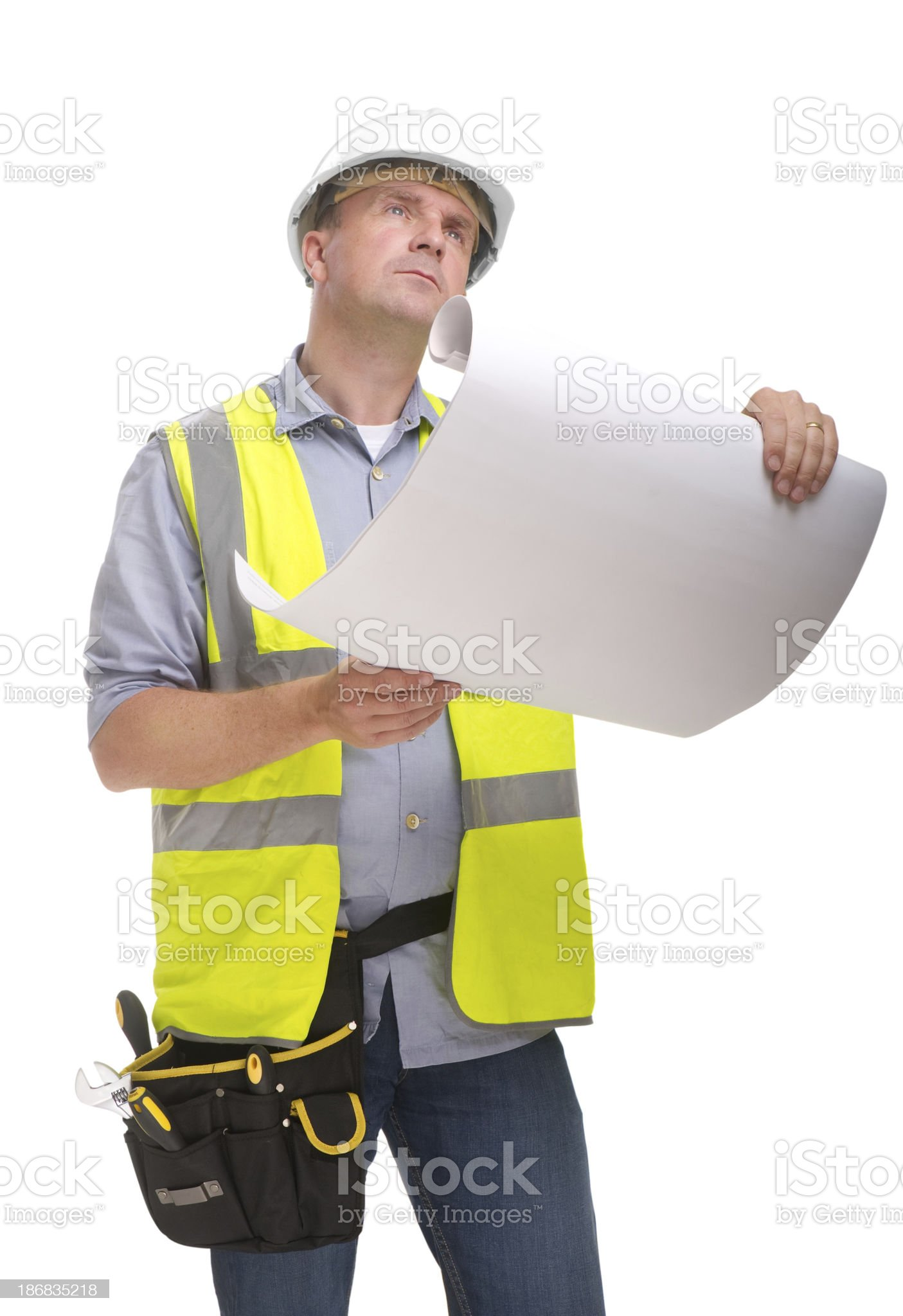 Construction worker with plans royalty-free stock photo