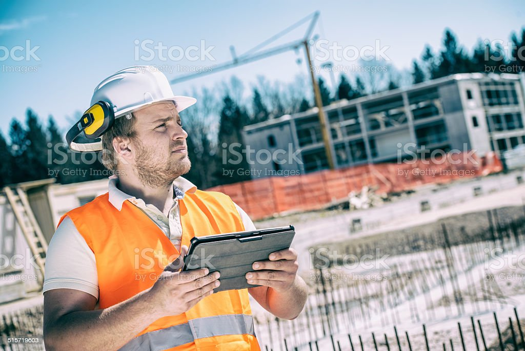 Construction worker with tablet computer stock photo