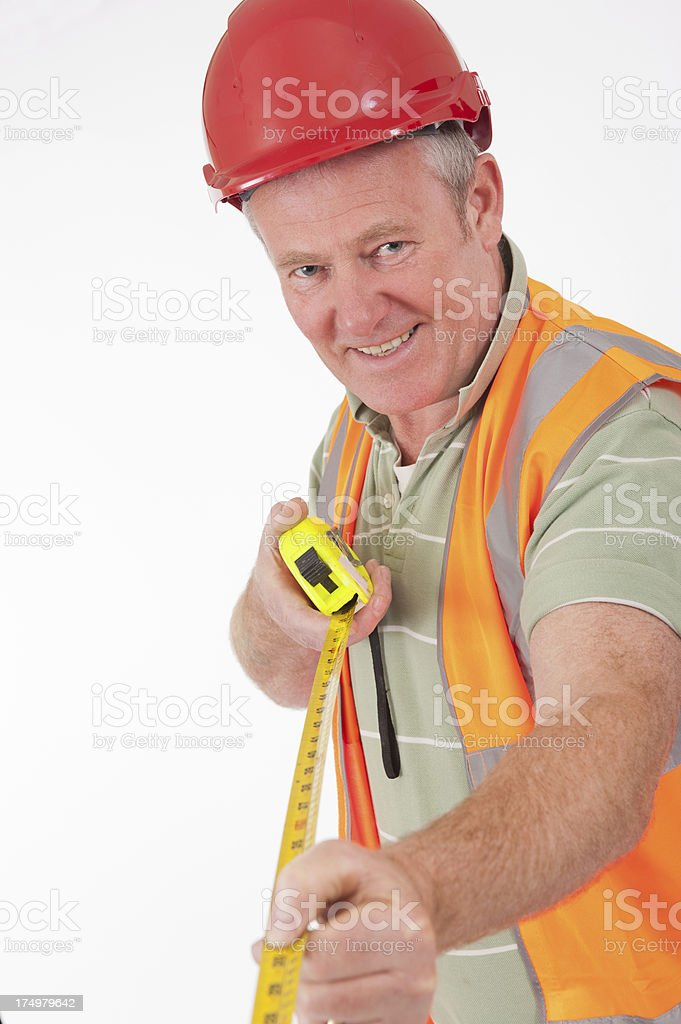 Construction Worker With Tape Measure royalty-free stock photo
