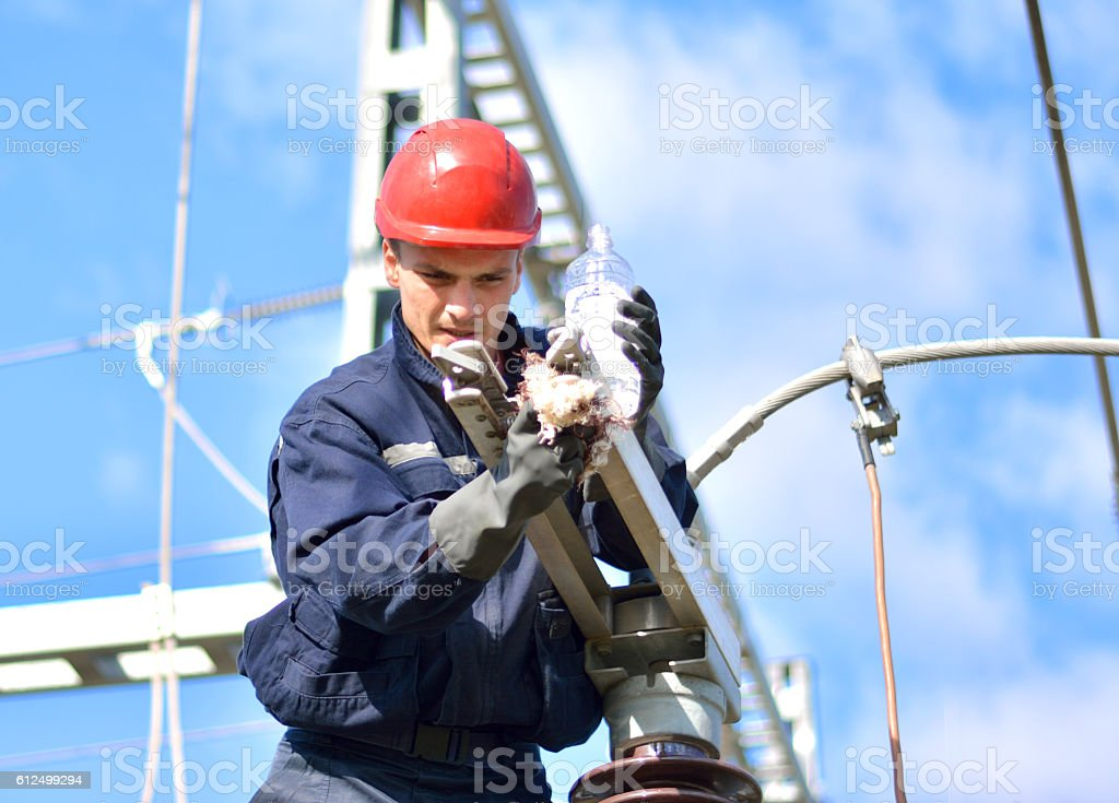 Construction Worker Working in Power Substation stock photo