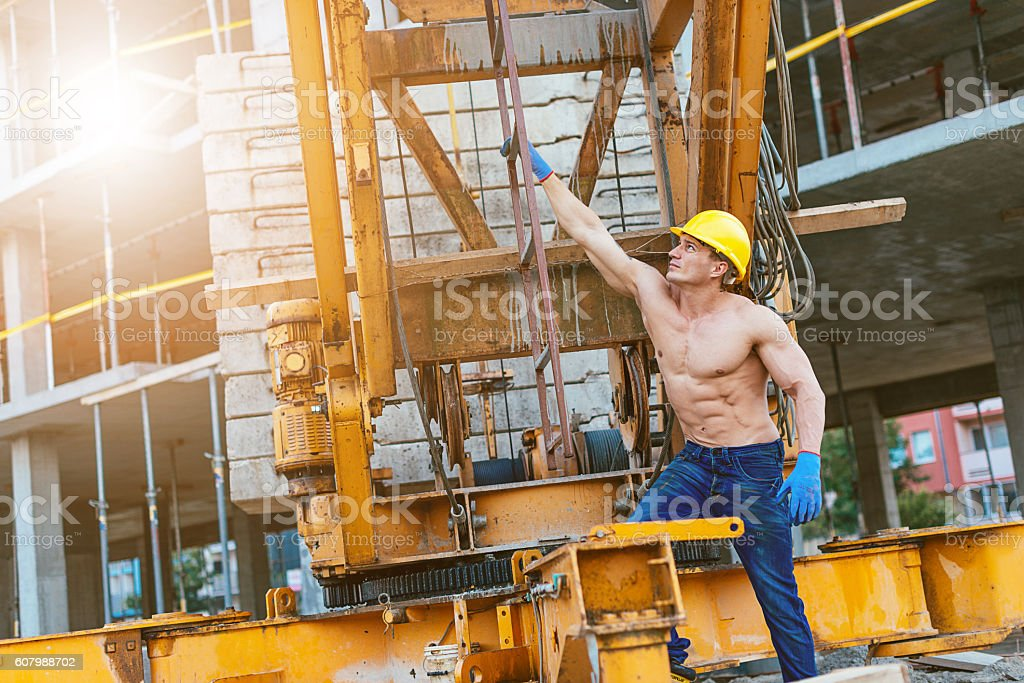 Construction worker working on construction crane stock photo