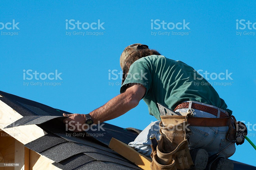 Construction worker working on the roof stock photo