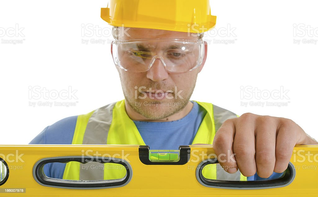 Construction Worker working with level. White background royalty-free stock photo