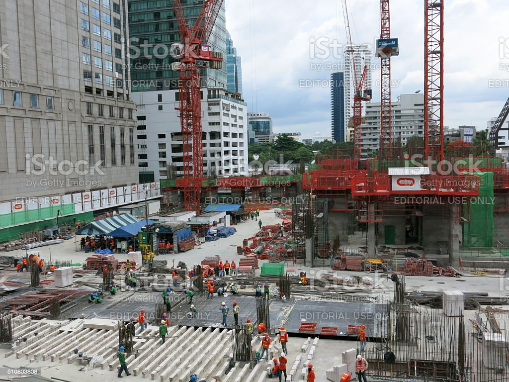Construction workers and cranes in Asia stock photo
