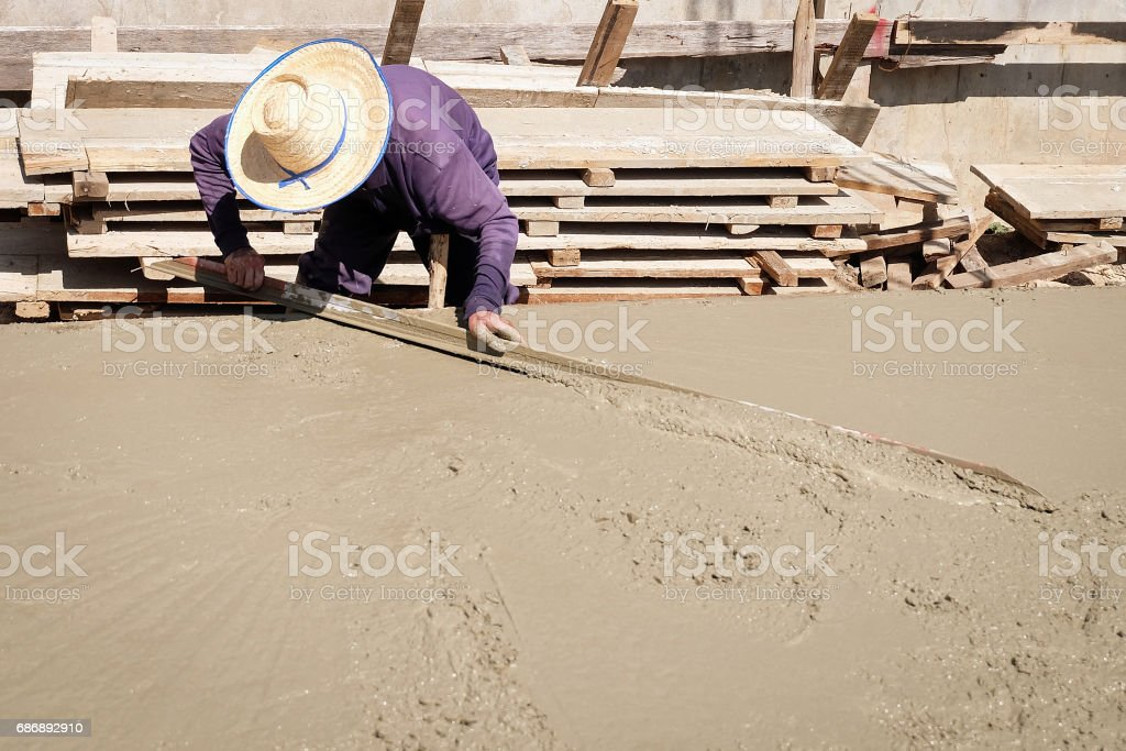 Construction workers are pouring cement of the building stock photo