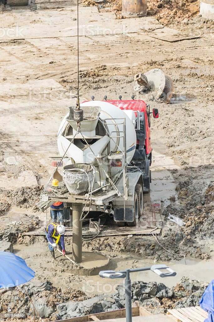 Construction workers are preparing pump for concrete for pouring stock photo