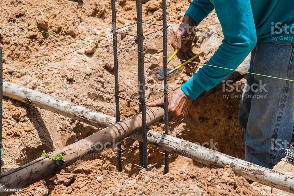 Construction workers are steel tie stock photo