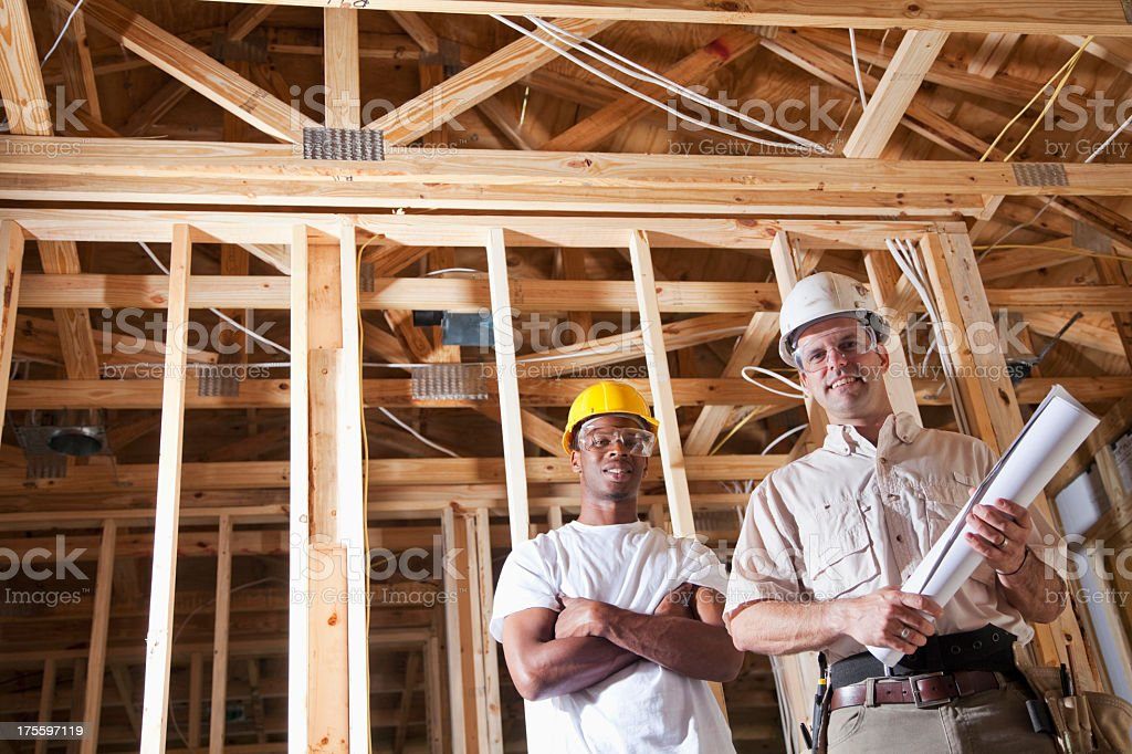 Construction workers at job site royalty-free stock photo