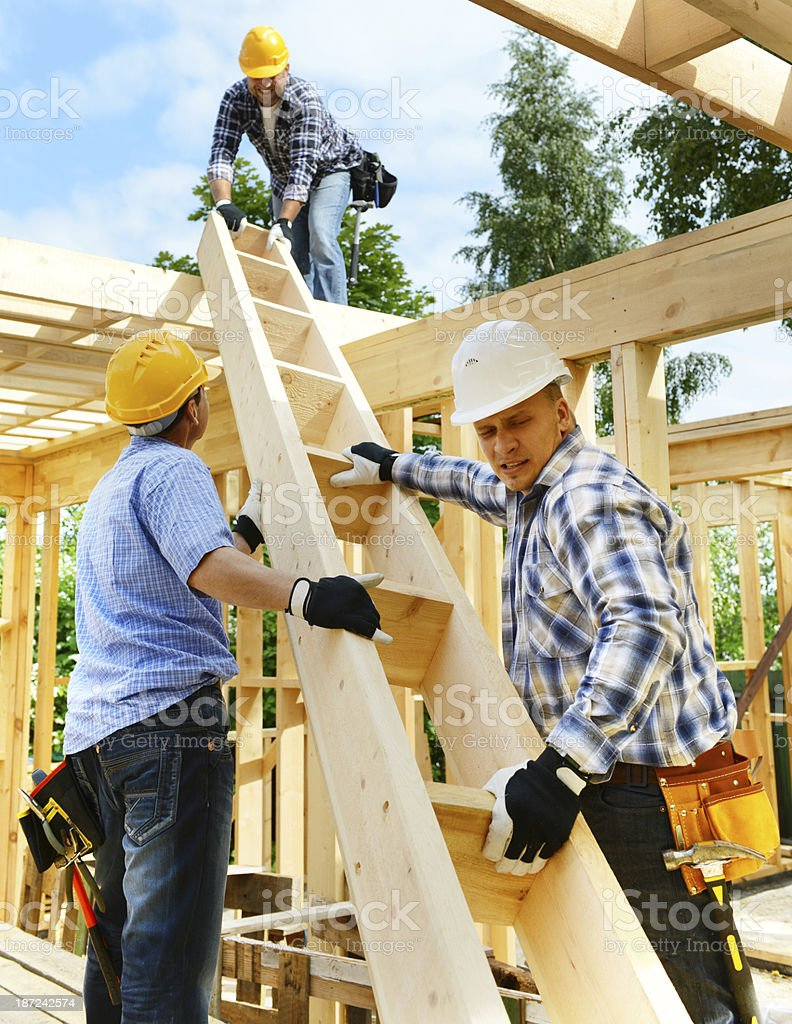 Construction workers building a house stock photo