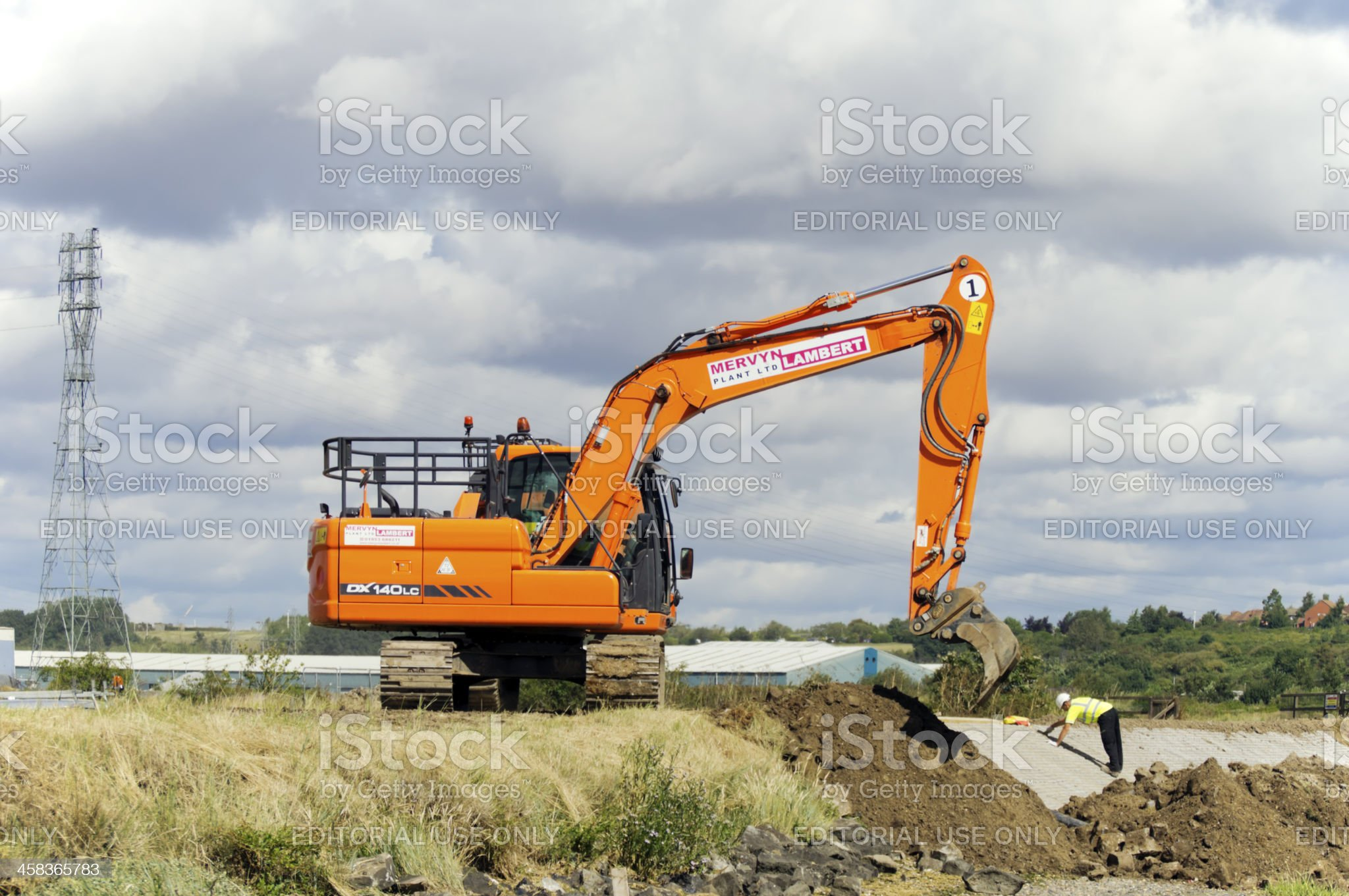 Construction workers building flood defences royalty-free stock photo