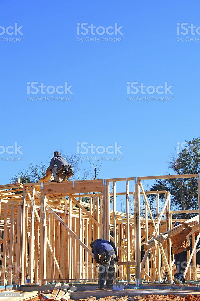 Construction Workers Building House royalty-free stock photo