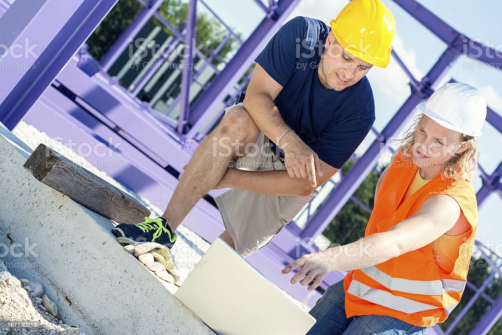 construction workers checking plans royalty-free stock photo