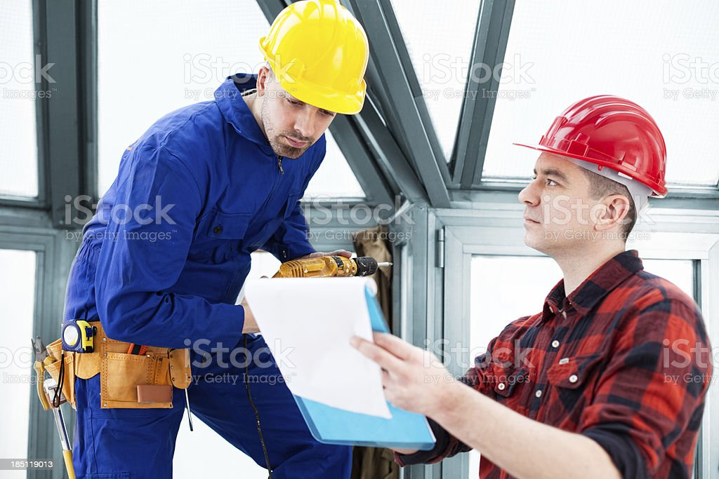 Construction Workers Consulting royalty-free stock photo