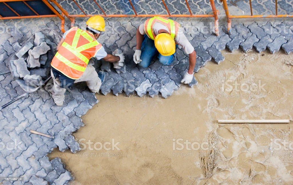 Construction workers fixing pavement stock photo