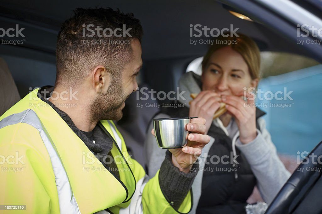 Construction workers having a lunch break in car stock photo