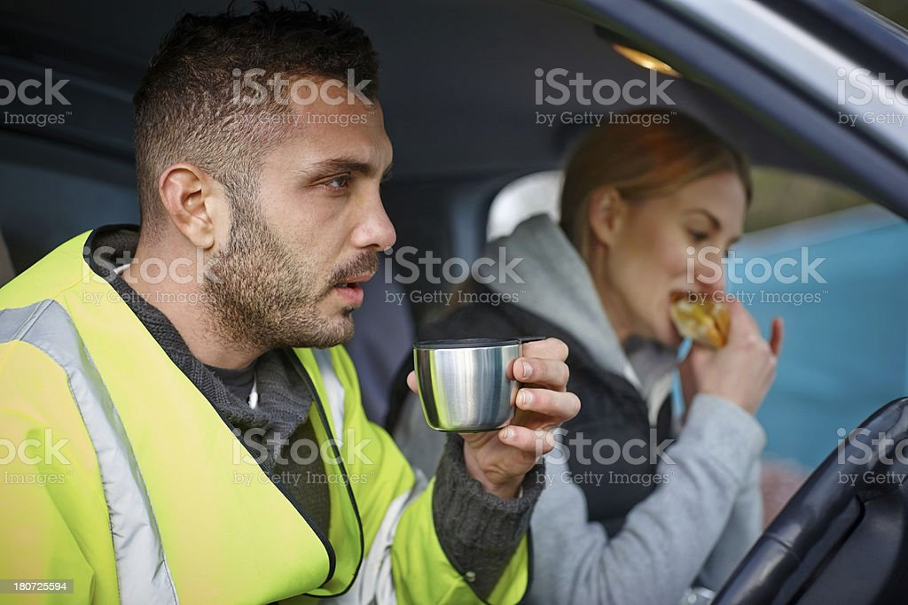 Construction workers having lunch break stock photo