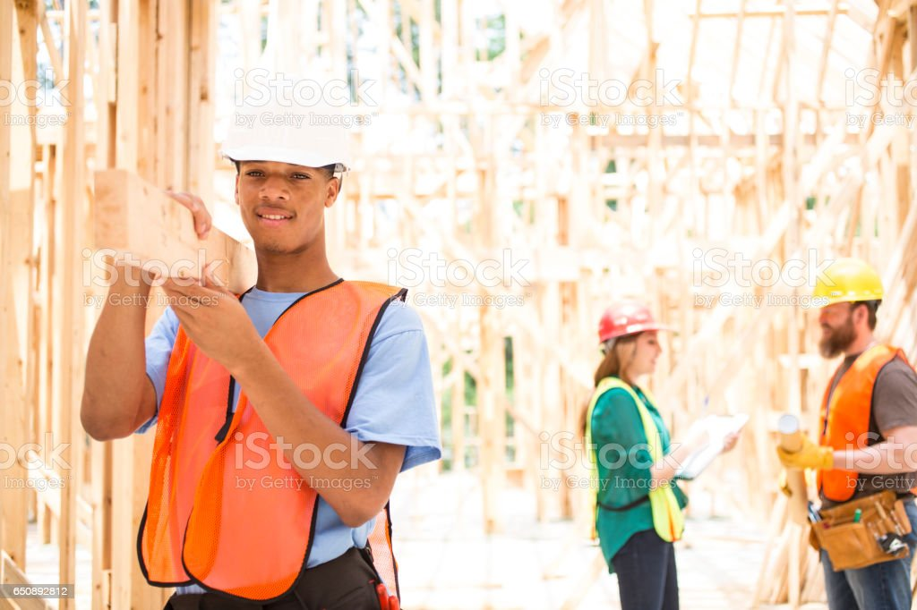 Construction workers in building site. stock photo